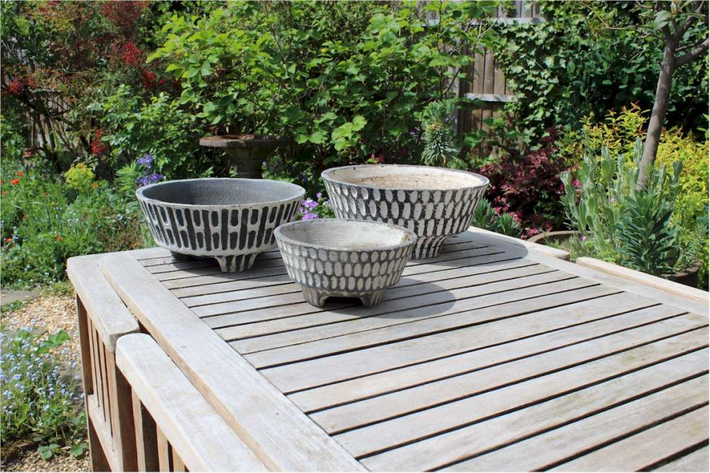Three Fifties garden pots. Black and white