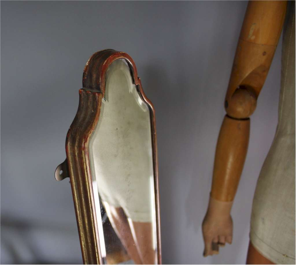 Victorian gilt shop mirror with shaped top