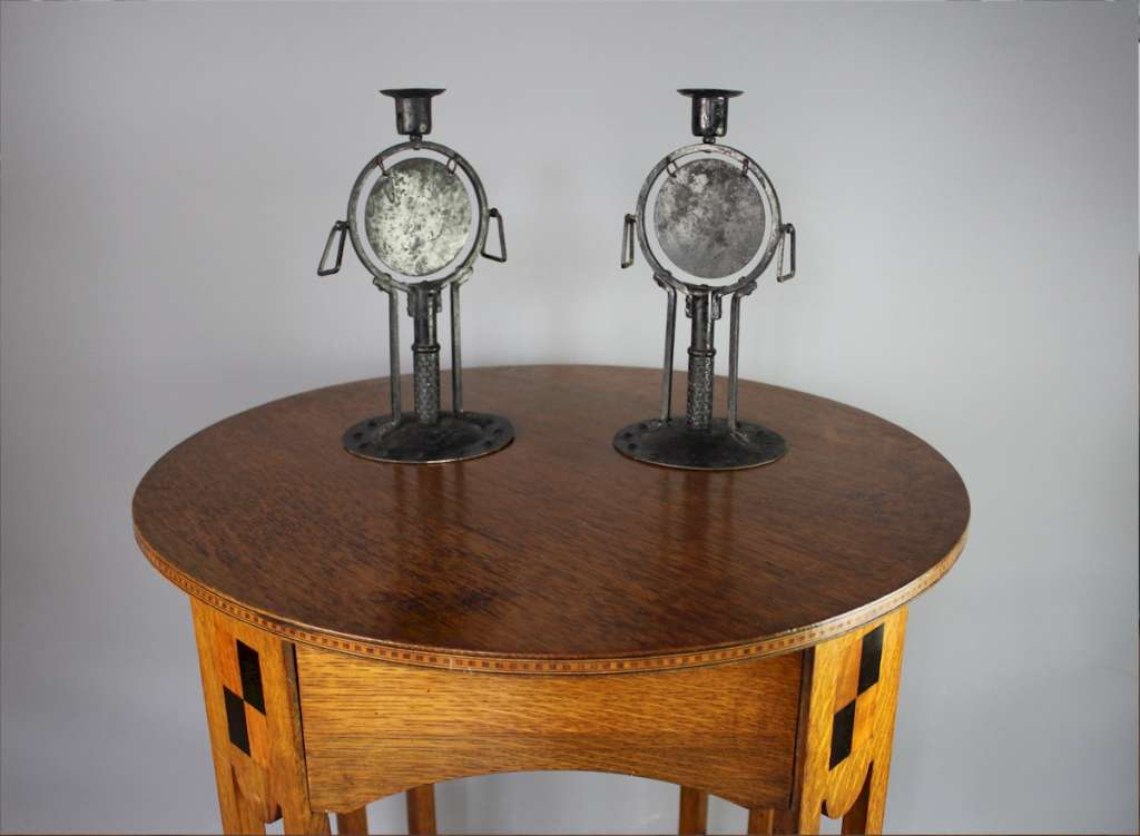Rare pair of arts and crafts candlesticks by Goberg