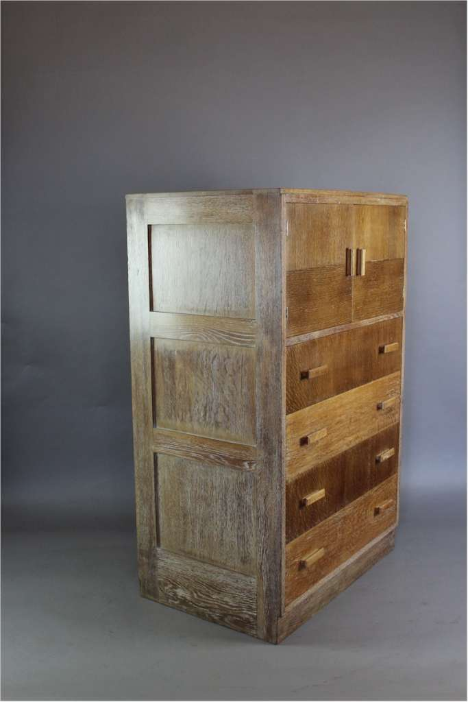 Heals 1930's tallboy with two door cupboard above four drawers