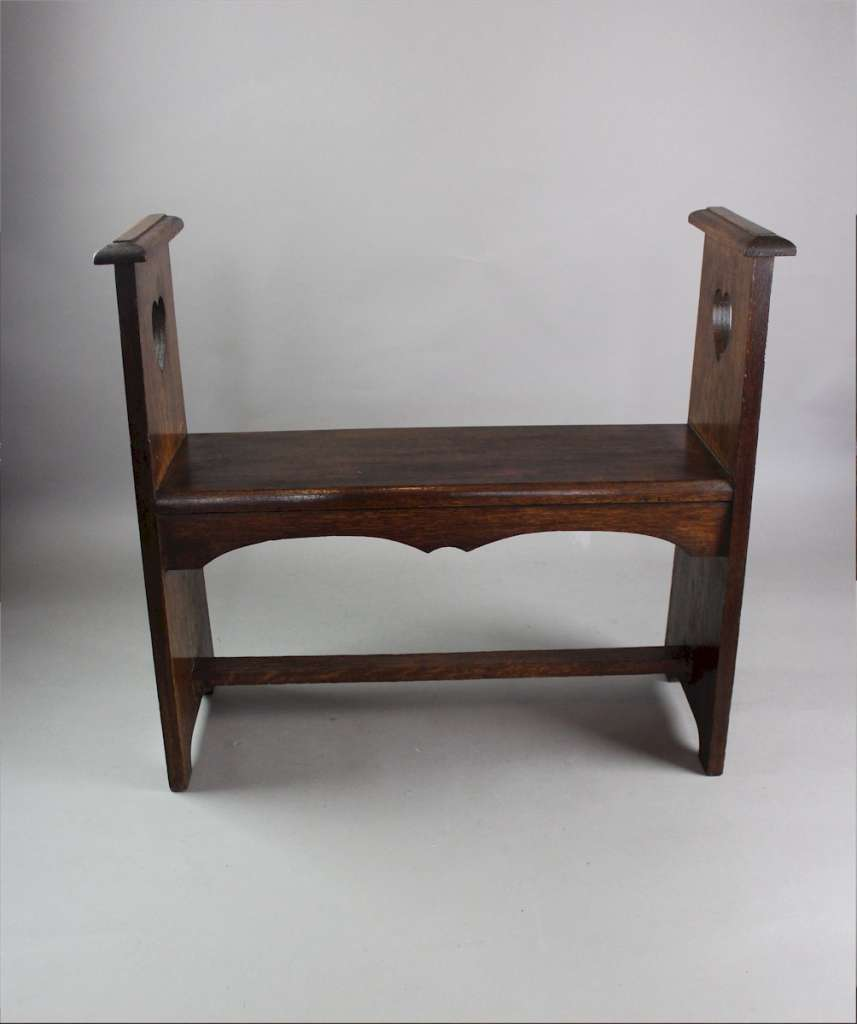 Liberty & Co oak window / hall seat , pierced heart cut-out c1900