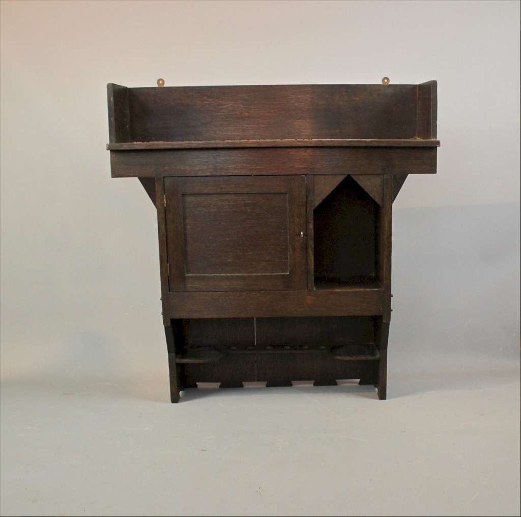 Arts and Crafts wall cabinet in oak by Liberty & Co