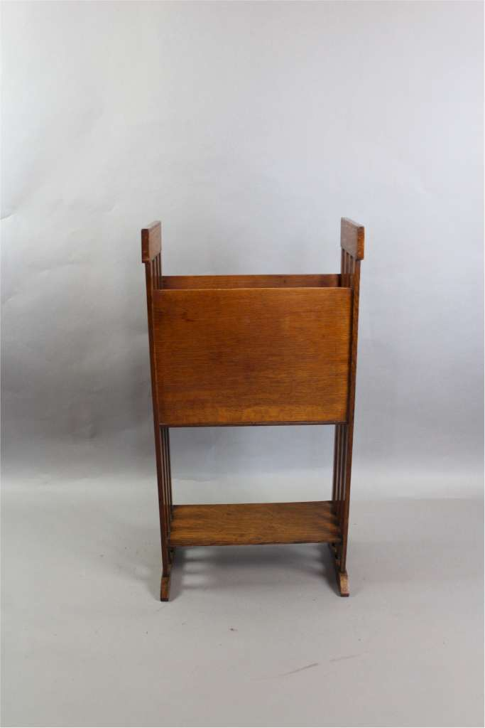 Arts and Crafts oak and leather magazine rack