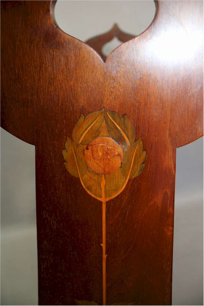Art Nouveau mahogany inlaid book trough with pierced cut-out