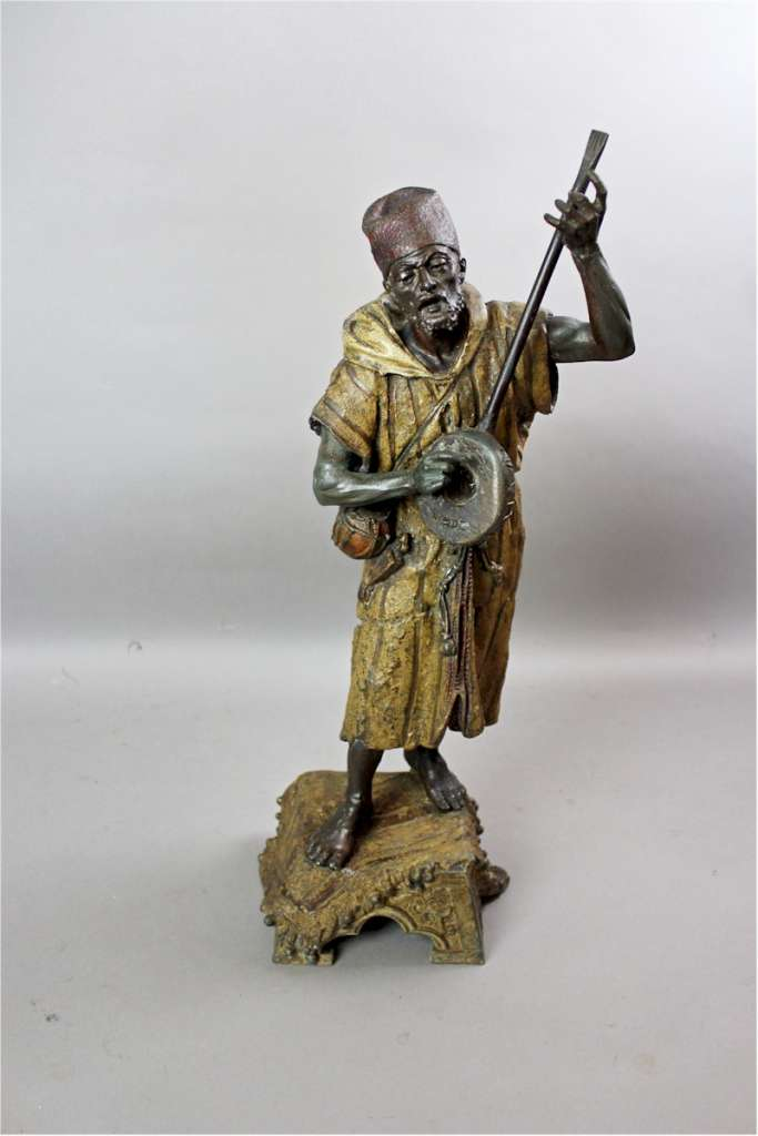 Large spelter figure of an Arab Bedouin playing the mandolin
