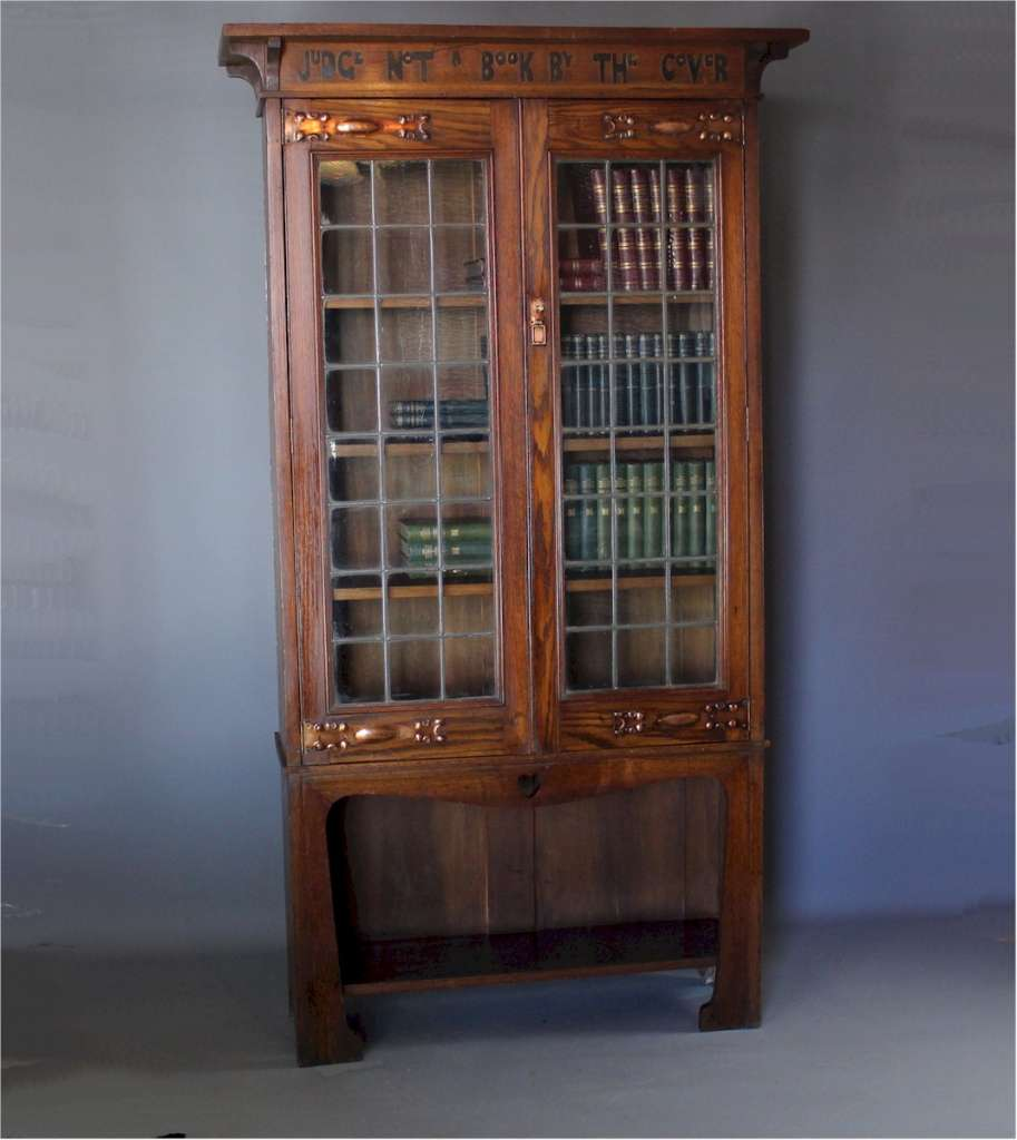 Arts and Crafts bookcase with Motto, Judge not a book by the cover.