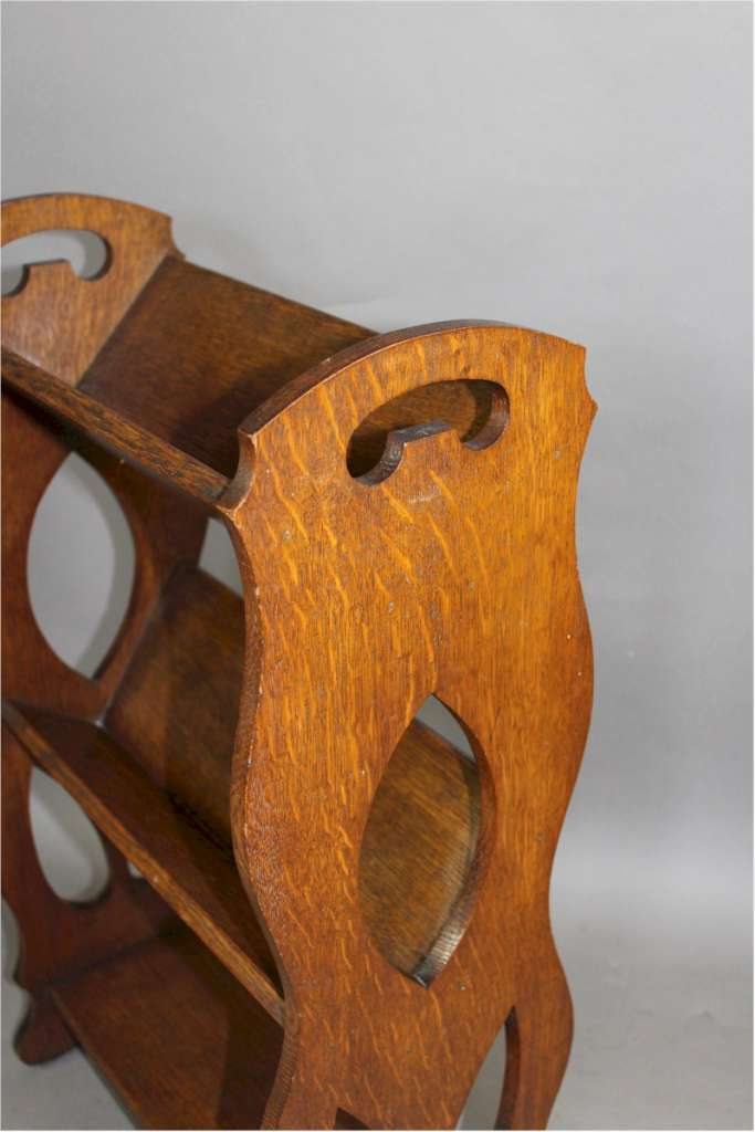 Arts and Crafts oak book rack with pierced handles