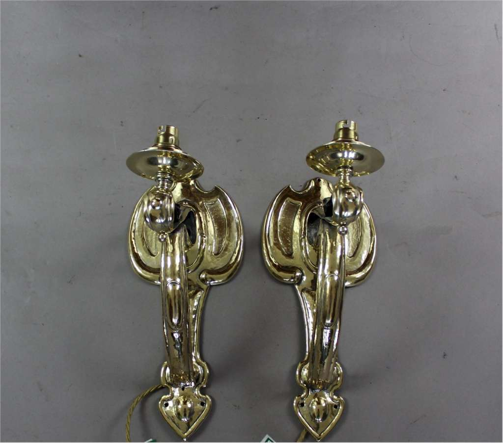 Pair of Arts and Crafts wall lights in brass c1900