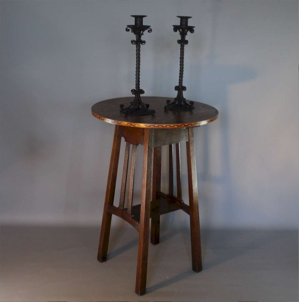 Pair of twisted iron candlesticks