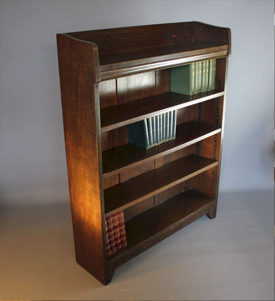 Pair of arts and crafts bookcases by Liberty & Co