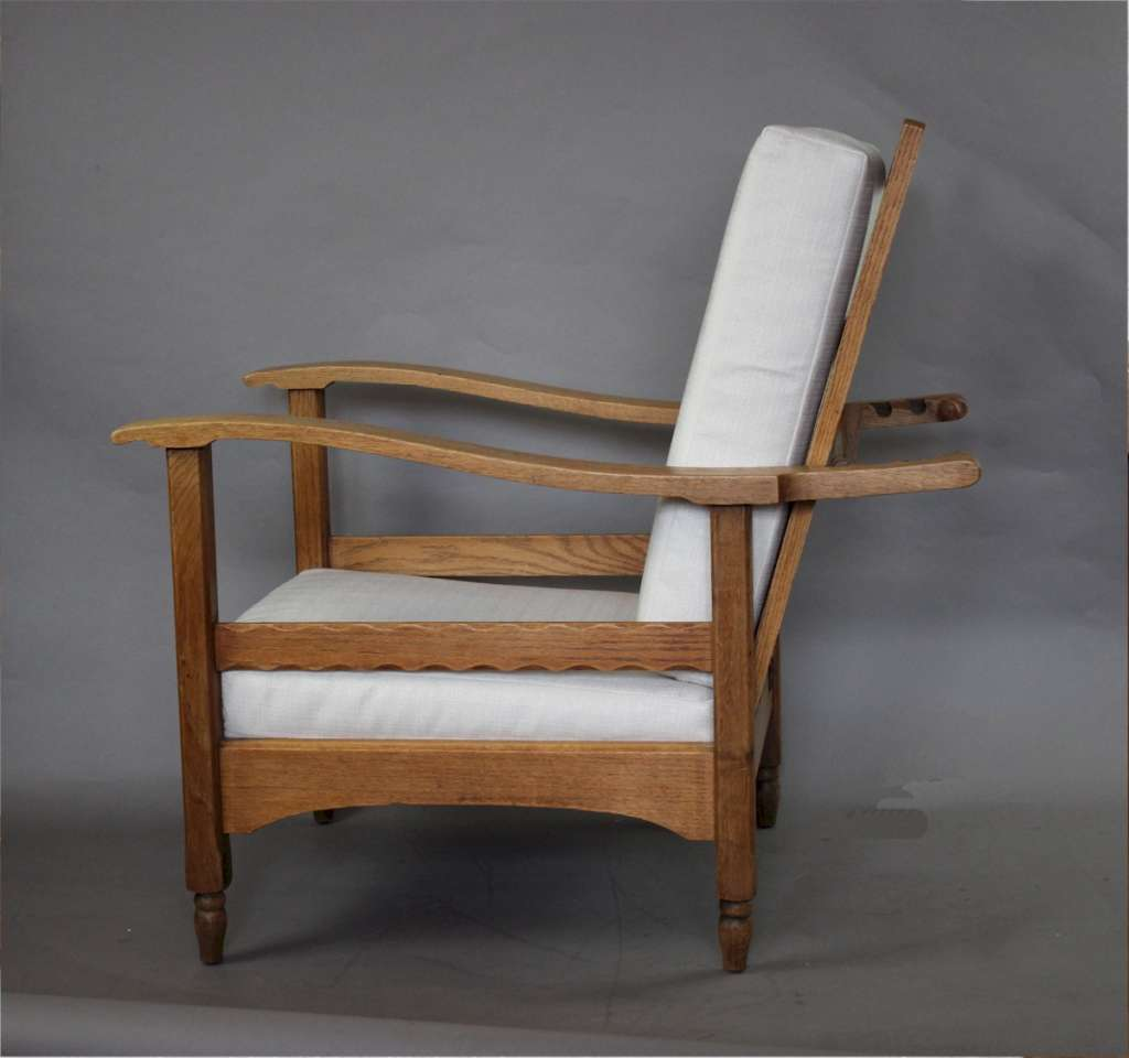 Pair of oak reclining armchairs in the manner of Heals c1920's