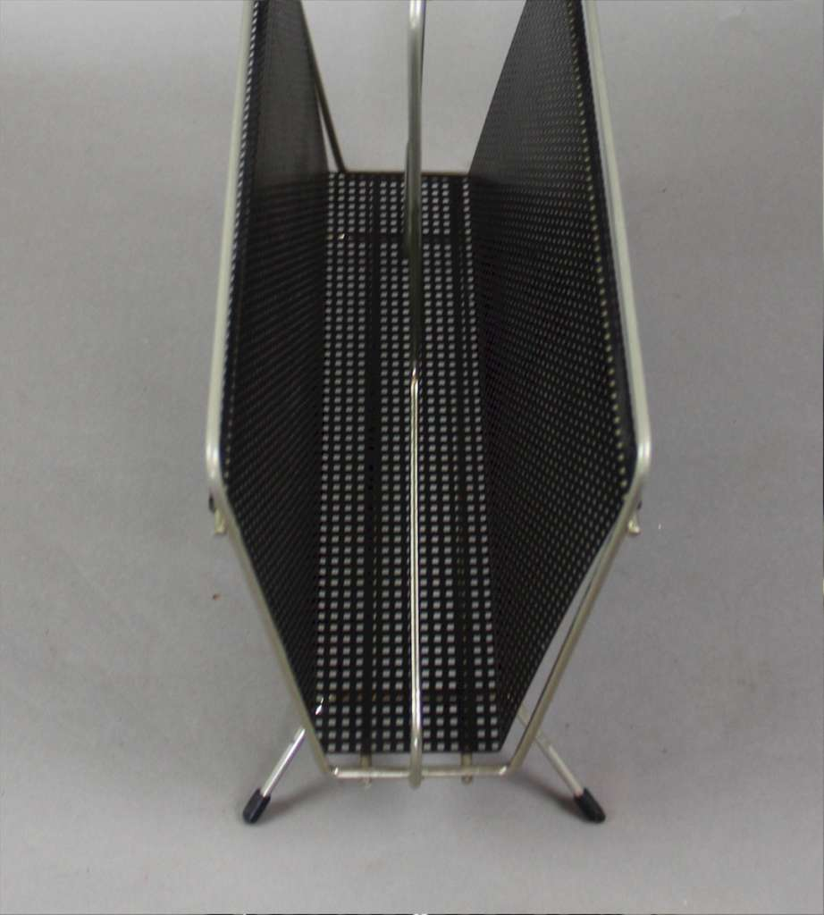 Perforated magazine rack from the 1950's