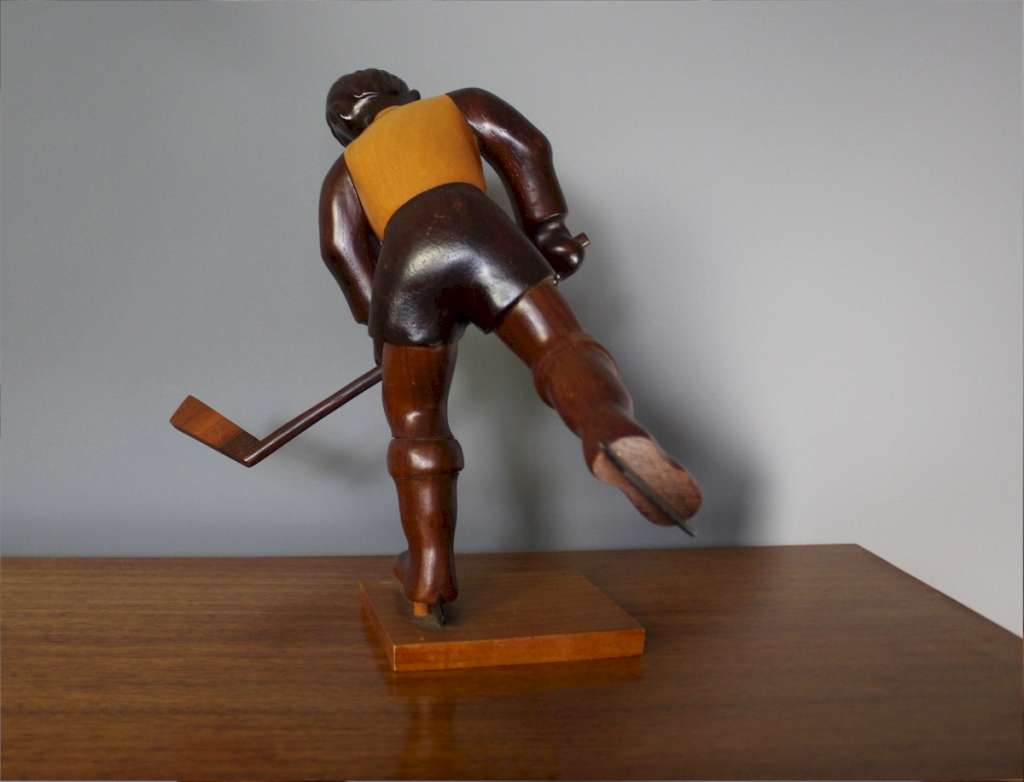 Italian mid-century Romer vintage carved figure of an ice hockey player