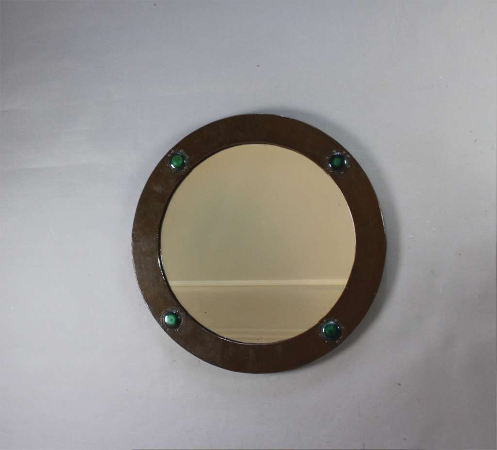 Arts and Crafts circular copper mirror with four Ruskin roundels . Liberty & Co