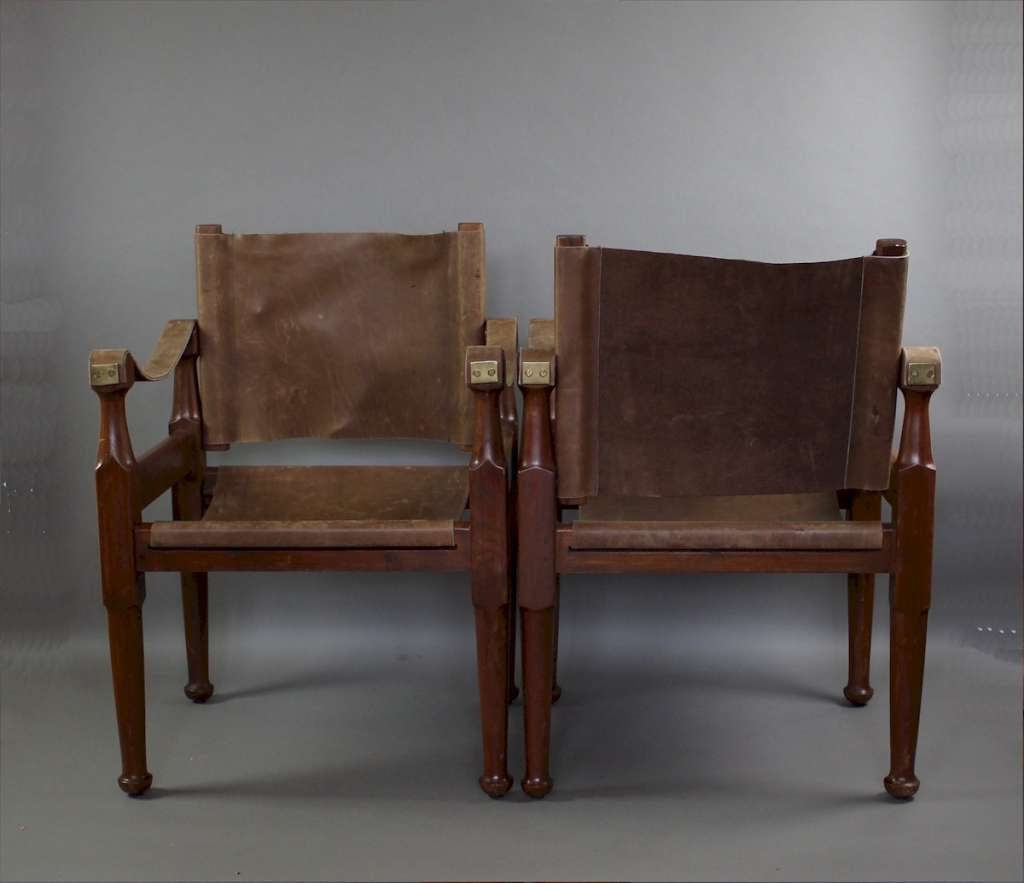 Pair of Safari chairs . Mid-Century teak and tan leather