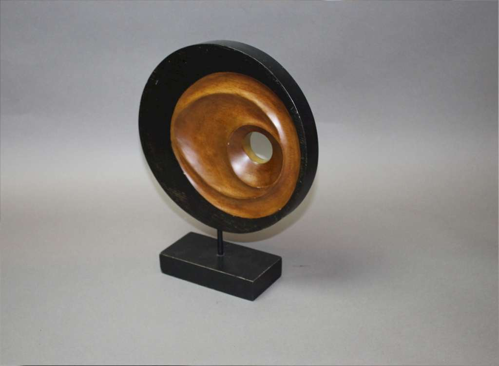 Mid century sculpture in wood on stand.