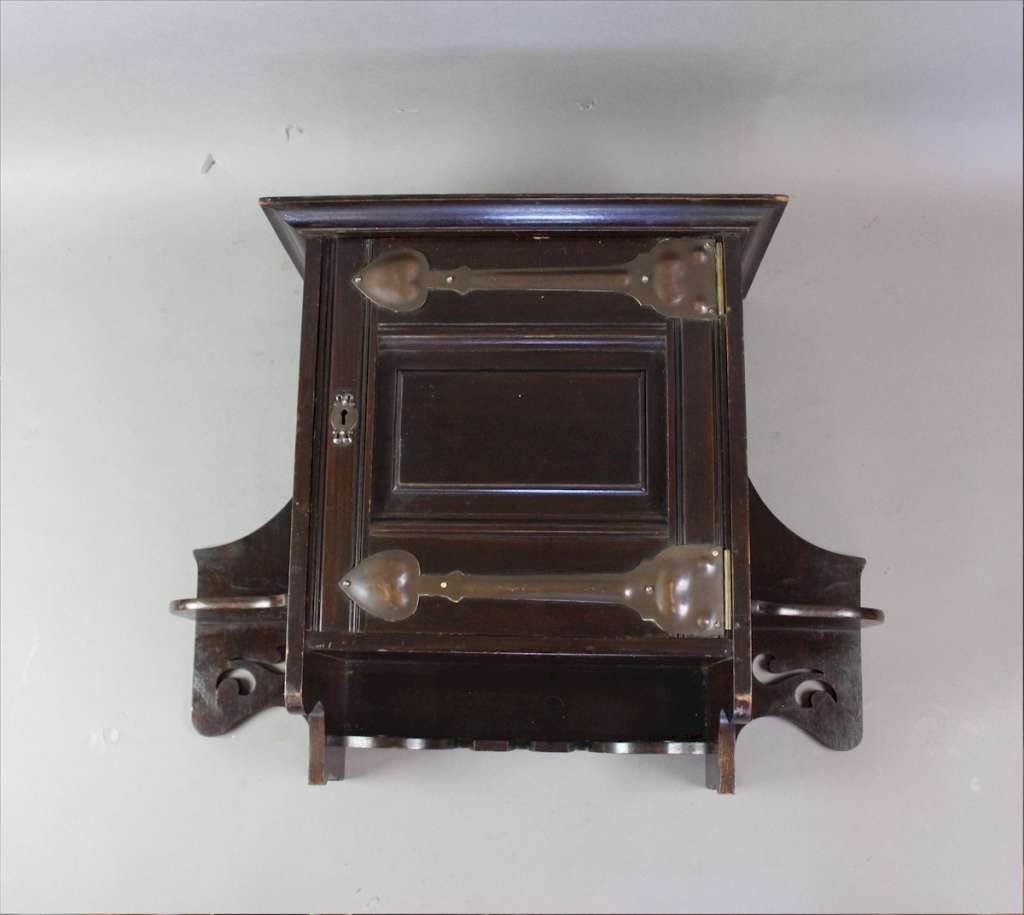 Arts and Crafts mahogany wall cabinet by Shapland and Petter