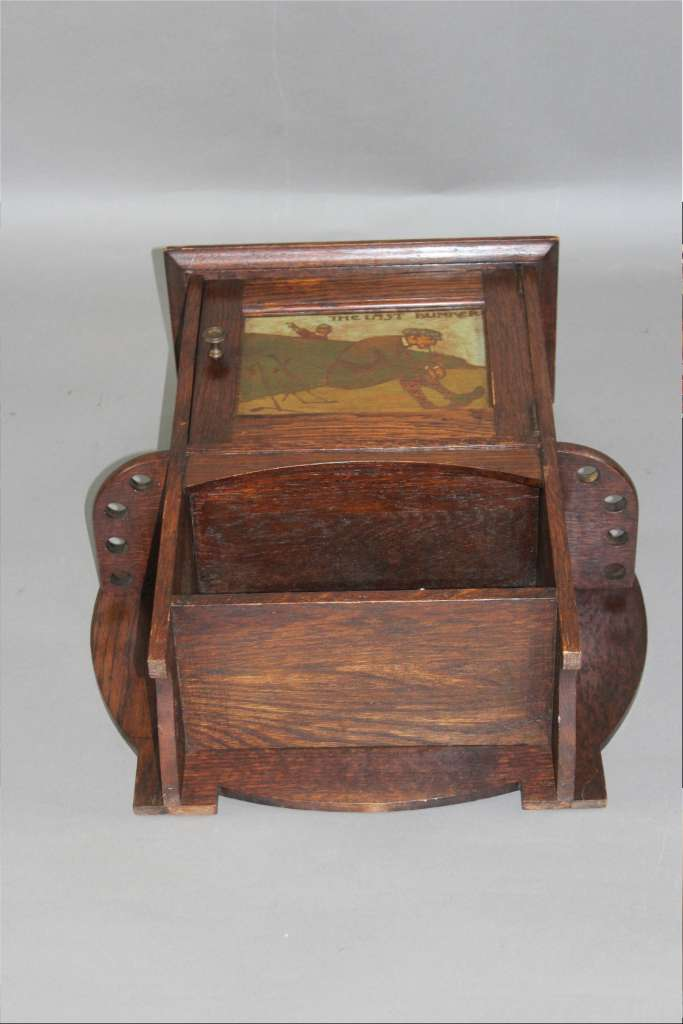 Arts and Crafts oak smokers cabinet by Liberty & Co c1900 with Golfing picture panel