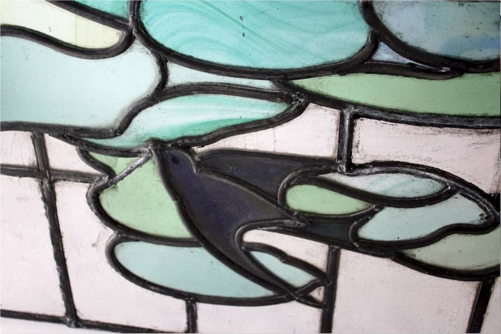 Arts and Crafts stained glass panel with Swallow