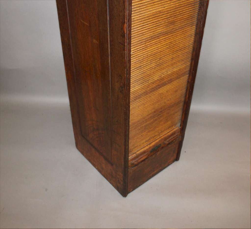 Tall oak filing cabinet by Globe c1897