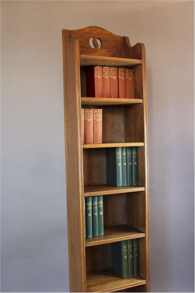 Tall arts and crafts open bookcase in oak with yin and yang cut-out