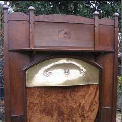 Arts and Crafts oak fire surround with brass canopy and matching fender