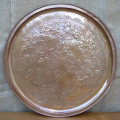 Large Keswick charger in repousse copper