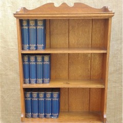 Unusual arts and crafts bookcase in oak with drop down table
