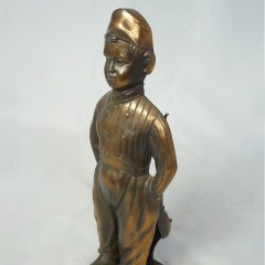 Fireplace companion set modelled as Dutch boy