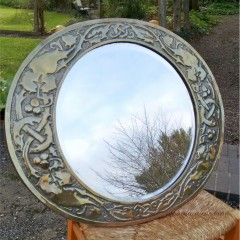 Arts and crafts brass mirror , repoussee leaves and berries