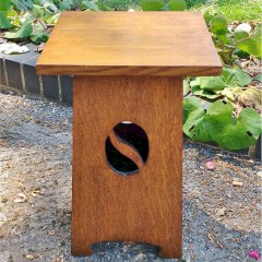 Small arts and crafts table with yin/yang cut-out decoration