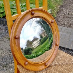 Circular convex mirror in golden oak attributed to Heals