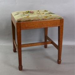Arts and Crafts oak stool byArthur Simpson and the Handicrafts of Kendal