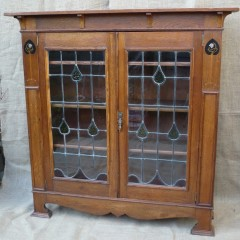 Arts and crafts inlaid bookcase in golden oak