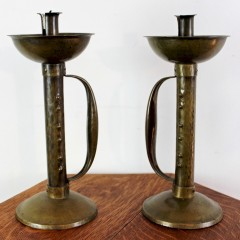 Pair of arts and crafts movement brass candlesticks