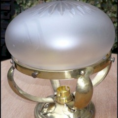 Small domed ceiling light in hammered brass