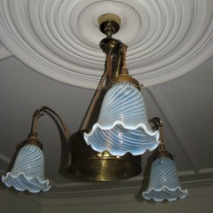 Arts and Crafts brass handing centre light with three arms, ceiling rose and period swirling vaselin