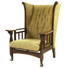 Arts and Crafts wing back oak armchair