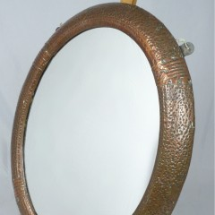 Small arts and crafts wall mirror in copper