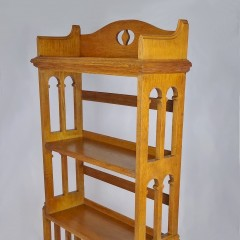 Arts and crafts bookcase with arched sides