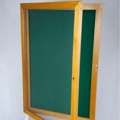 1950's lockable notice board in golden oak