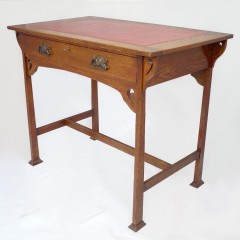 Good arts and crafts desk in golden oak with leather top