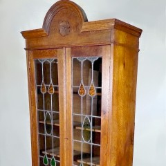 Arts and crafts glazed bookcase in golden oak
