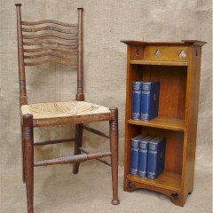 Arts and crafts trefoil bookcase in golden oak