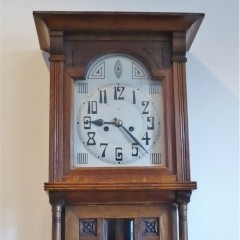 Arts and crafts wall clock in oak