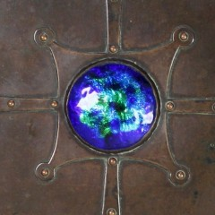 Arts and Crafts copper casket with enamelled roundel by A E Jones