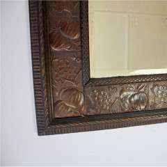 Aesthetic Movement wood and copper framed mirror.
