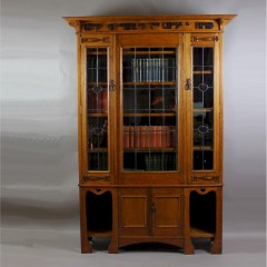 Arts and Crafts oak glazed bookcase with Motto