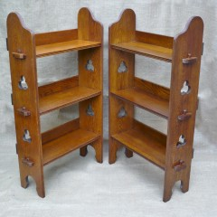 Pair of Liberty & Co bookcases in golden oak