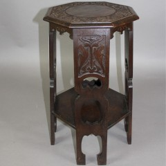 Arts and crafts carved oak occasional table with pierced cut outs